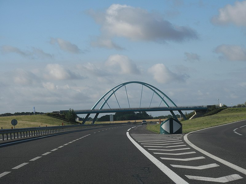 The rest area of Villeroy on french highway Autoroute A19, with its crossing bridge, France
