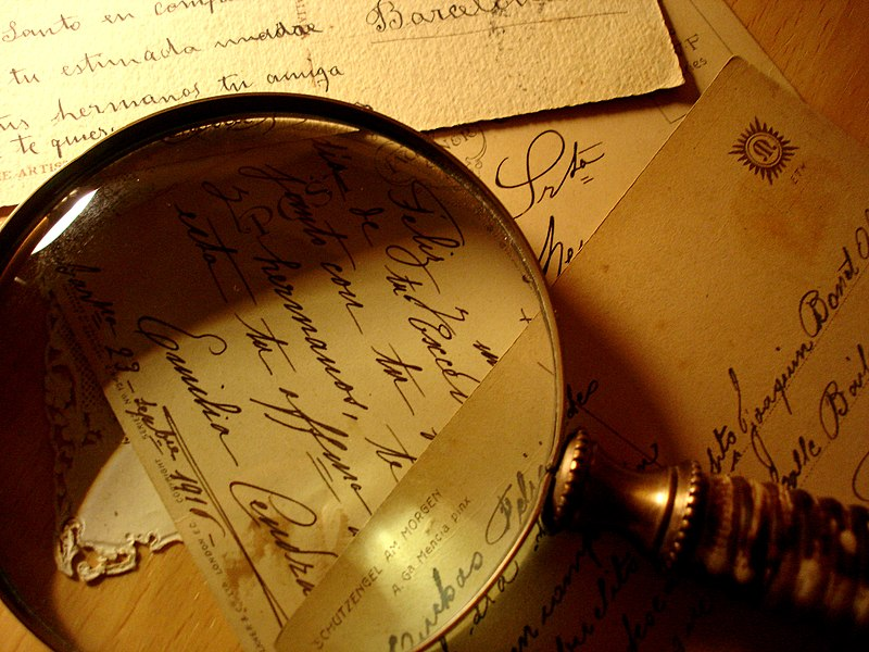 File:Postcards and magnifying glass.jpg