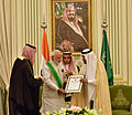 Prime Minister Narendra Modi being conferred Saudi Arabia's highest civilian honour, the King Abdulaziz Sash.jpg