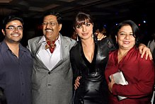 Priyanka Chopra and her family are looking towards the camera.