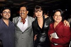 Priyanka Chopra and her family are looking towards the camera.