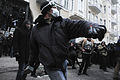 Protester, throwing a piece of paving during at riot police during clashes at Bankova str, Kiev, Ukraine. December 1, 2013.jpg