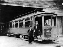 New Orleans Public Service's Prytania streetcar line, 1907. Two uniformed men stand by entrance, presumably the motorman and the conductor. Streetcar is at Arabella Station carbarn.