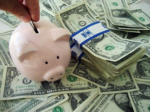 Putting money into a piggybank