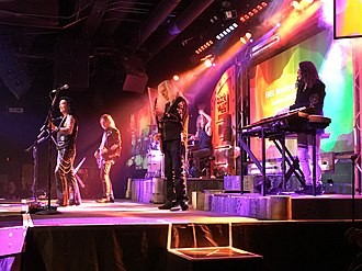 Raiding the Rock Vault - A performance of the show at the Hard Rock Hotel & Casino Las Vegas in 2019, featuring (from left to right): Robin McAuley, Christian Brady, Howard Leese, Blas Elias, and Michael T. Ross.