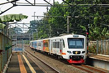 Railink EA203 passing Sudirman Station.jpg