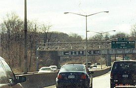 "Graffiti on a railroad bridge in Queens, New York City written as ""CHUNE""."