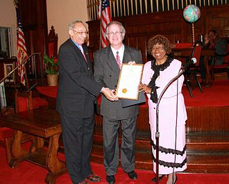 Ray Reach - Ray Reach receiving a resolution from Alabama State Legislature on February 21, 2013. Left to right: Unidentified Alabama State Representative, Reach and Alabama State Representative Barbara Boyd. Photo taken at First Baptist Church, Montgomery, Alabama.