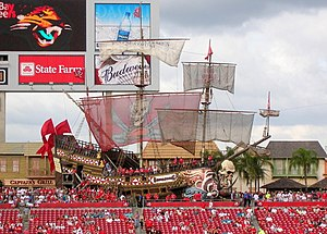 A large pirate ship behind the seats in the stadium