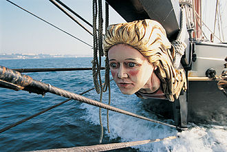 "Figurehead - A literal ""figurehead"", a wood-carved decoration in the prow of a ship. Much like a literal figurehead aesthetically represents the ship while being irrelevant to its actual seafaring, a political figurehead holds an high-profile office while having little actual power."