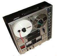 A reel-to-reel tape recorder (Sony TC-630).  The magnetic tape is a storage medium. The recorder is data storage equipment using a portable medium (tape reel) to store the data.