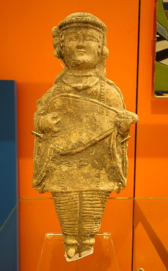 Oud - Iran, 11th or 12th century a.d. Earthenware statue of a musician playing a short-necked, lute-style instrument.