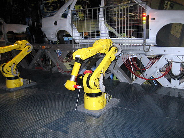 From commons.wikimedia.org: Robot worker {MID-133384}