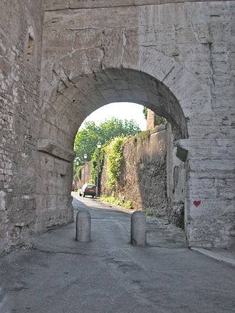Socii - Gate in the Servian Wall of Rome, on the Caelian Hill. The wall, made of massive tufa stone blocks, was built just after Rome was sacked by the Gauls in 390 BC
