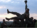Romanian naval infantrymen celebrate the birthday of U.S. Marine Corps Lance Cpl. John R. West II, a rifleman with Black Sea Rotational Force 11, by throwing him up in the air, a tradition within their ranks 110523-M-OB762-001.jpg
