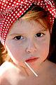 Rosie with a lollipop and polka-dot bandana.jpg