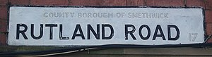 "County borough - Street nameplate on Rutland Road, Smethwick in April 2007, showing painted out ""County Borough"" lettering."