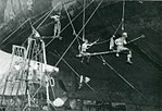 Sailors clean the bottom of USS Lunga Point (CVE-94) in a floating drydock at Guam, in May 1945.jpg