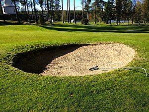 Golf etiquette - After a bunker shot a player should rake the sand smooth again