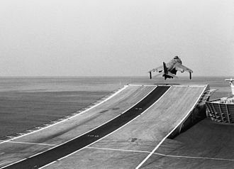 British Aerospace Sea Harrier - Harrier FRS.1 of 800 NAS using the ski-jump during takeoff from HMS Invincible in 1990