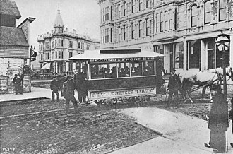 Seattle - Seattle's first streetcar, at the corner of Occidental and Yesler, 1884. All of the buildings visible in this picture were destroyed by fire five years later.