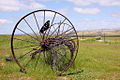 Side view of an old dump hay rake.jpg