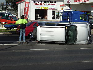 Small SUV on its side after an accident on the...