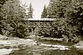 South Siuslaw River flowing under a bridge at Cascadia State Park.jpg