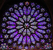 Rose window from the Basilica of St. Denis, Paris, showing Jesse at the centre. This is not the earliest St Denis Jesse window, which is vertical like Chartres.