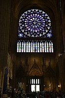 Stained-glass rose window at Notre Dame de Paris.jpg