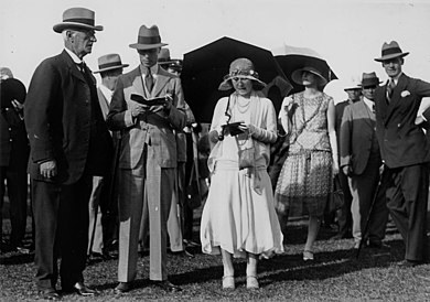 The Duke and Duchess of York (centre, reading programmes) at Eagle Farm Racecourse, Brisbane, 1927 StateLibQld 1 110084 Duke and Duchess of York at Eagle Farm Racecourse, Brisbane, 1927.jpg
