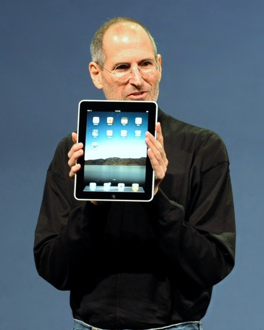 Steve Jobs with the Apple iPad no logo (cropped)