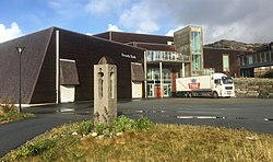 Stranda skule, primary school in the Municipality of Sund, Hordaland, Norway, entrance, monument by Nico Widerberg, Tine dairy truck, 2017-10-25 c.jpg