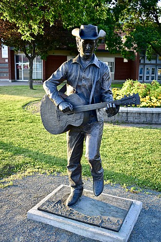 Stompin' Tom Connors - The 2015 bronze statue of Stompin' Tom, with Connors' left hand positioned for chord of C-, one of the major chords in the song Sudbury Saturday Night