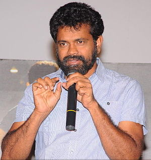 Sukumar (director) - Sukumar promoting 1: Nenokkadine (2014) in a press meet.