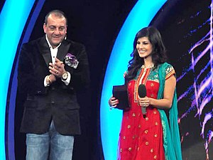 Bigg Boss 5 - Host Sanjay Dutt with Bollywood Star Sunny Leone after her eviction from the house