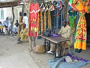 A Chadian tailor sells traditional dresses.