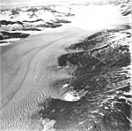 Taku Glacier, tidewater glacier with firn line in the background and hanging glaciers on the mountainsides, September 1, 1977 (GLACIERS 6235).jpg