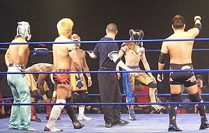 Akira Tozawa - Tozawa (third left), along with Kagetora and Super Shisa representing Dragon Gate in the 2011 King of Trios tournament, where they faced The Osirian Portal in the quarter-finals