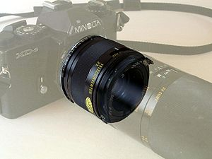 Lens mount - A teleconverter attached between a camera and its objective