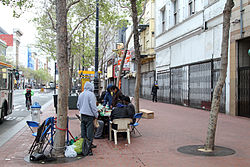 People playing chess along Market St in Tenderloin