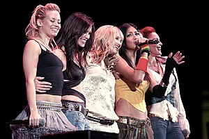 "The Pussycat Dolls (L-R: Kimberly Wyatt, Jessica Sutta, Ashley Roberts, Nicole Scherzinger, and Carmit Bachar) performing ""Stickwitu"" in 2005."