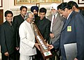 The Captains of the 5 Premier Hockey League teams along with the President of the Indian Hockey Federation (IHF) Shri K.P. S. Gill presenting a Hockey stick to the President Dr. A.P.J. Abdul Kalam in New Delhi on November 29, 2005.jpg