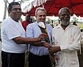 The Mayor of Belmopan, Simeon Lopez, British High Commissioner to Belize Patrick Ashworth and the Governor General Sir Colville Young posing with the Queen's Baton 2010 Delhi.jpg