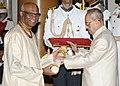 The President, Shri Pranab Mukherjee presenting the Padma Shri Award to Shri Madhu Pandit Dasa, at a Civil Investiture Ceremony, at Rashtrapati Bhavan, in New Delhi on April 12, 2016.jpg