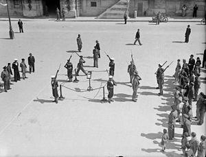 The King's Own Malta Regiment - Maltese ratings changing guard with the King's Own Malta Regiment
