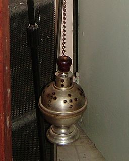 Thurible metal censer suspended from chains, in which incense is burned during worship services