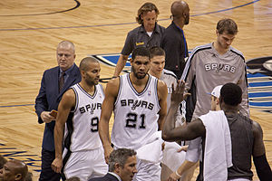 San Antonio Spurs approach bench during a timeout.