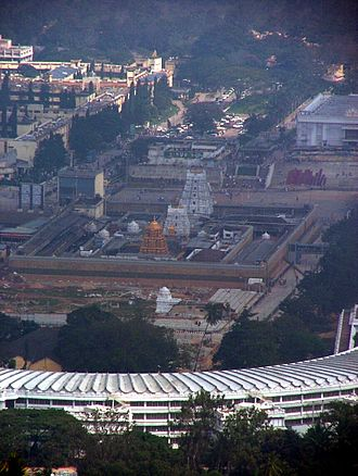 Krishnadevaraya - Tirumala Temple and Vaikuntam Queue Complex (semicircular building in the foreground) as seen from Srivari Padalu on Narayanagiri hill