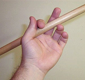 Traditional grip - Traditional grip (detail). Note the signature 'underhand' grip of the style